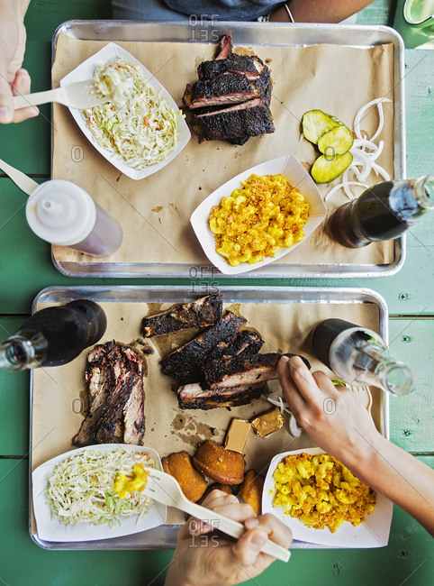 Friends eating barbecue food - Offset