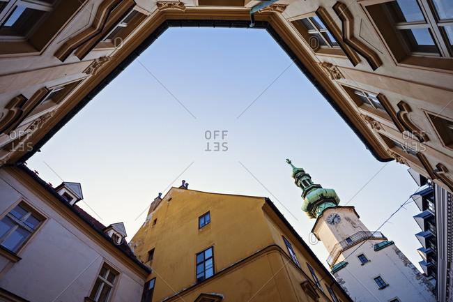 Townhouses and tower against sky, Bratislava, Slovakia