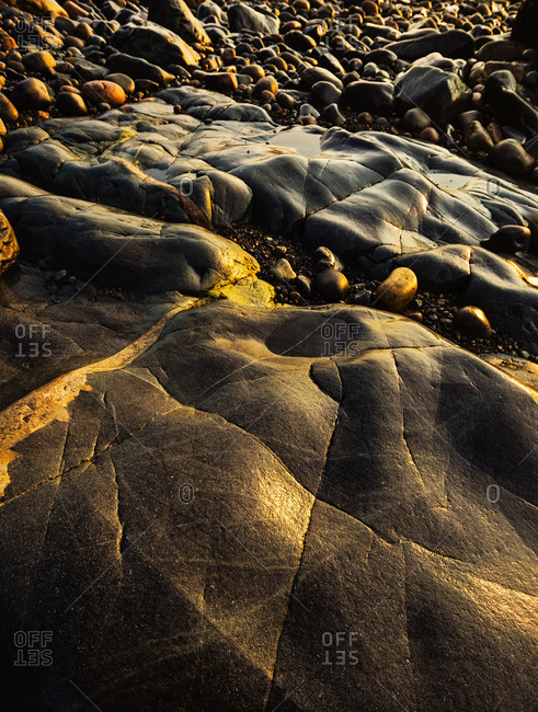 Rocks and pebbles on beach in Acadia National Park