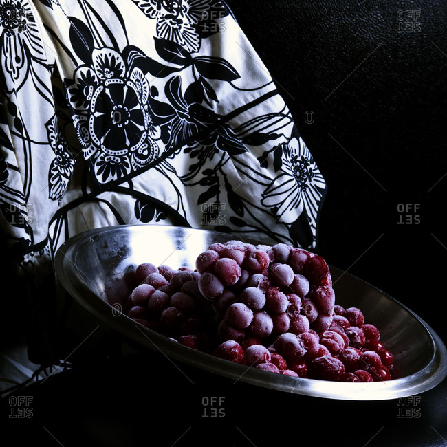 Bowl of frozen berries and a floral pattern fabric