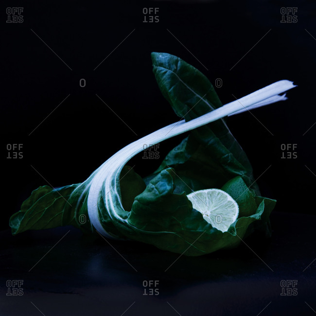 Bok choy leaf and a wedge of lime