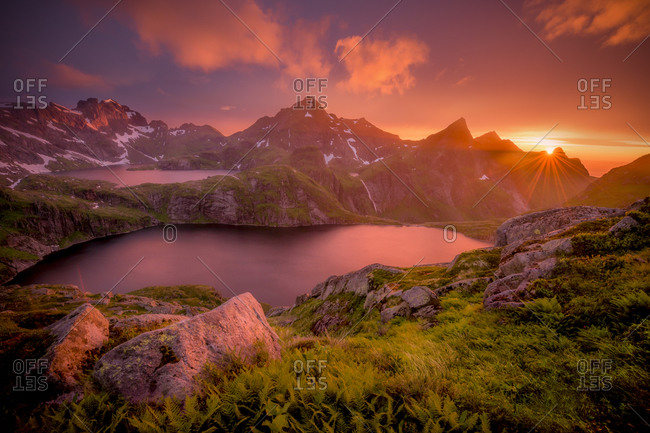 An amazing sunset over two lakes and a waterfall