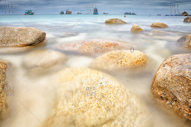Rocks in shallow water Aow Leuk in the South China Sea