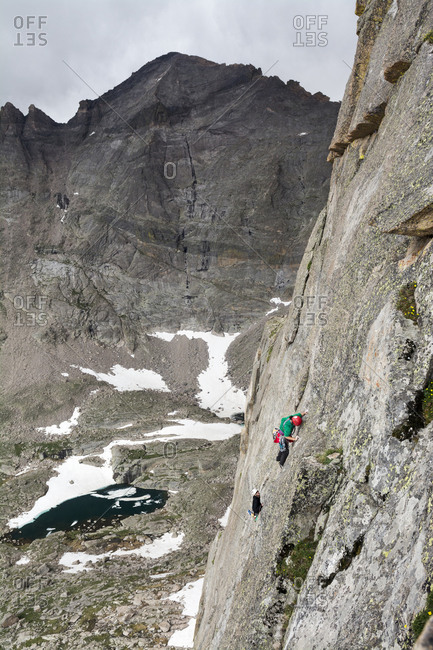 A man and woman rock climbing in Rocky Mountain National Park, Estes Park, Colorado