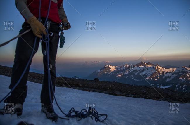 A climber on the snow slopes of Mount Rainier in Mount Rainier National Park, Washington, USA