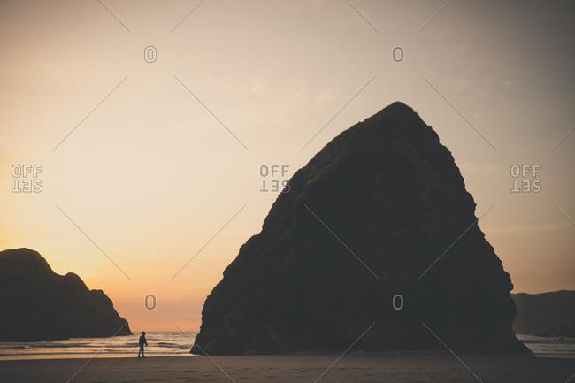 Woman walking on Gold Beach