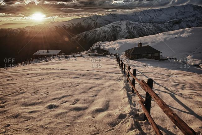 Rural buildings in a winter landscape