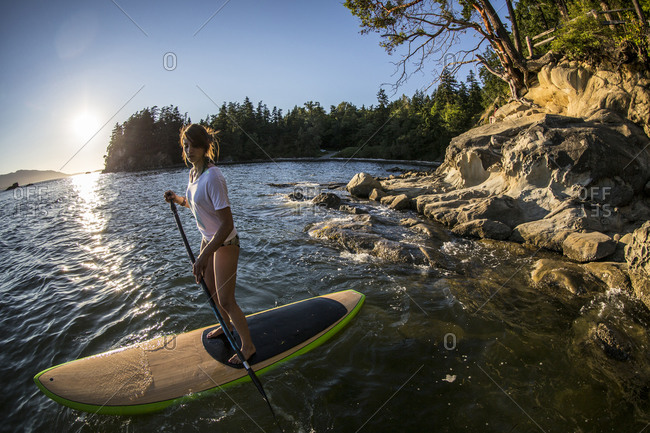 Young woman on a paddleboard
