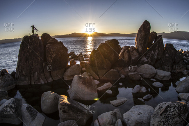 Climber on a rock in Lake Tahoe