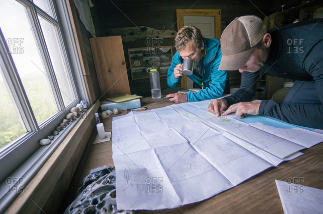 Two men planning the days hike in Aniakchak, AK