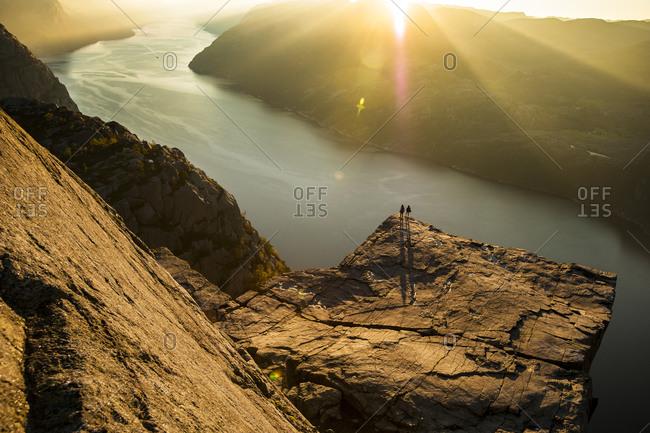 Two people overlooking a river near Preikestolen, Stavanger, Norway