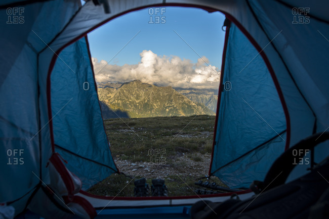 View of mountains through a tent's door Devero National Park, Piemonte, Italy