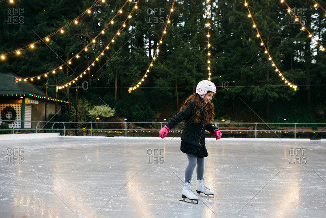 Girl ice skating at an outdoor rink