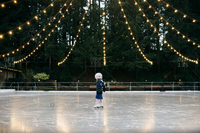 Little girl ice skating at an outdoor rink