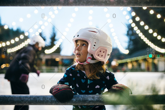Girl taking a break from ice skating