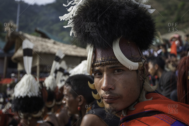 Nagaland, India - December 9, 2015: Portrait of man in traditional Naga costume at festival in India