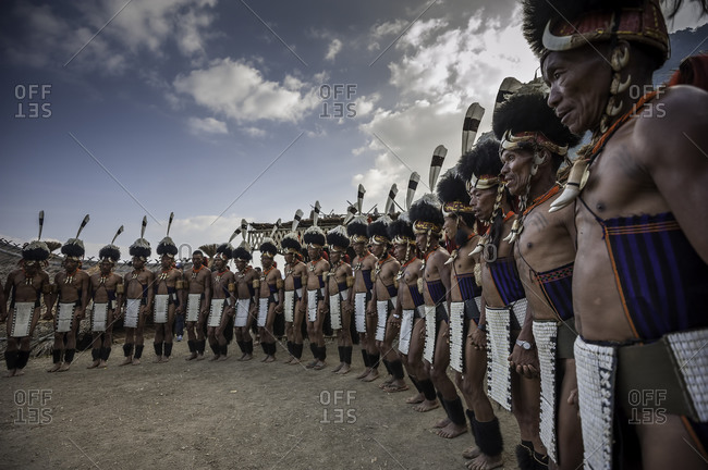 Nagaland, India - December 9, 2015: Group of Naga men in traditional costumes at festival in Northeast India