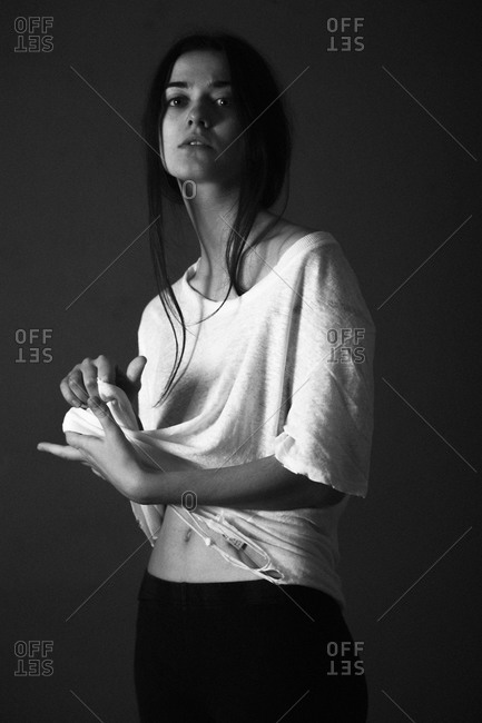 Portrait of a young woman in a torn tee-shirt