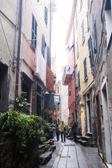 Cinque Terre, Italy - October 6, 2015: People walking though streets in a village in Cinque Terre, Italy