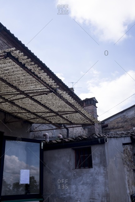 Building with corrugated roof in Crespina, Italy