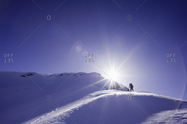 Skier at the top of a snowy mountain