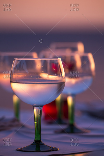 Drinks in glasses at sunset