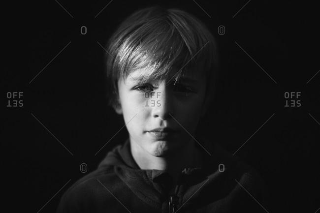 Portrait of a boy in a hooded sweatshirt