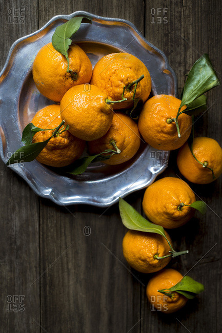 Silver plate of fresh tangerines