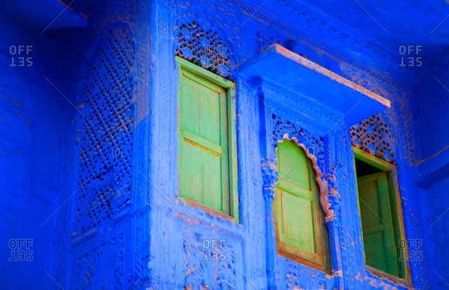 Close up of windows on blue buildings in Jodhpur, India