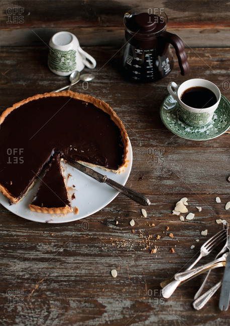 Chocolate tart served with coffee