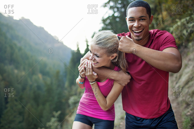 Young couple goofing around while on a hike
