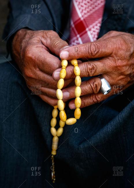 Man holding worry beads in Amman, Jordan