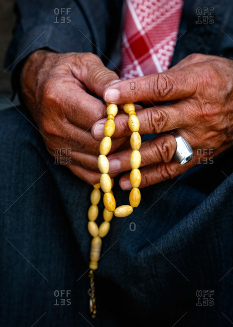 Man holding worry beads in Amman, Jordan