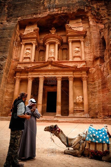 Petra, Jordan - November, 2010: Men with a camel at the Treasury (El Khazneh) in Petra, Jordan