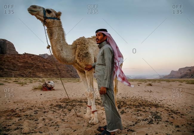 Wadi Rum, Jordan - November, 2010: Bedouin man and his camel in Wadi Rum, Jordan