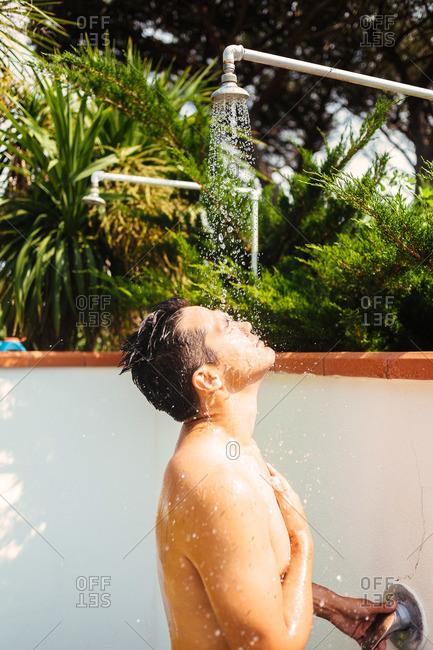 Man showering outdoors