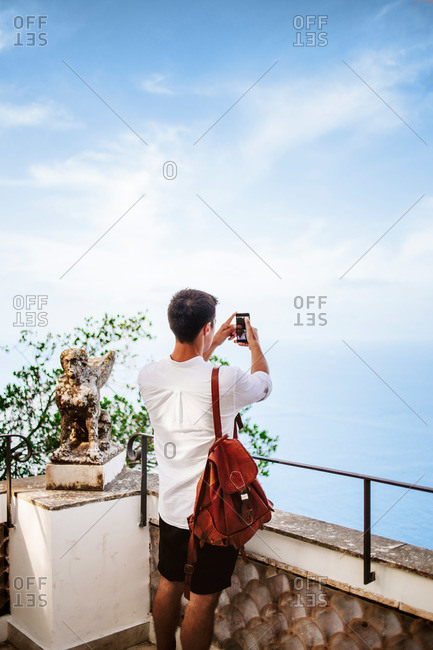 Man taking picture of the sea in Capri, Italy