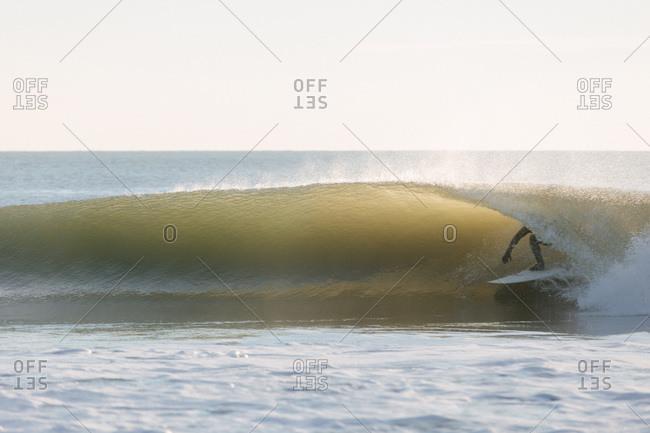 Surfer riding inside a wave