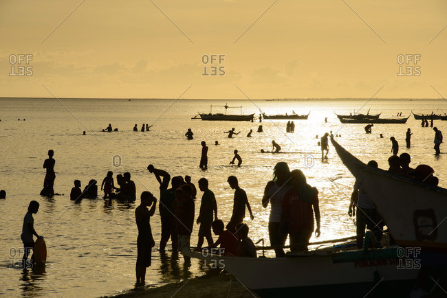 Cebu, Philippines - January 1, 2015: Crowds of people in the ocean
