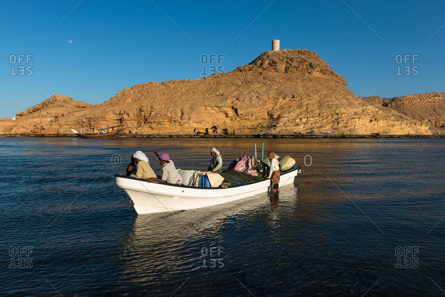 Sur, Oman - February 1, 2015: Fishermen bringing in their catch