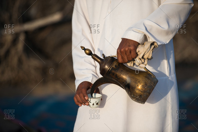 Pouring tea at a festival outside of Muscat, Oman
