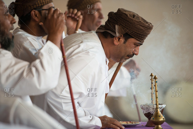 Muscat, Oman - February 4, 2015: Men performing a ritual at a festival outside of Muscat, Oman