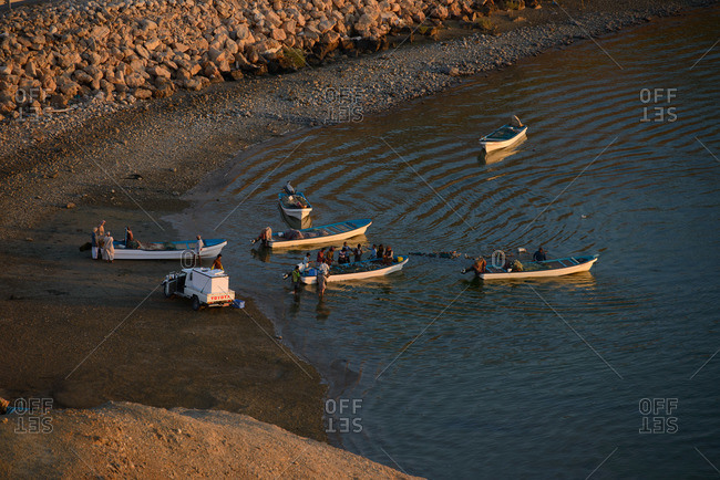 Sur, Oman - February 1, 2015: Fishermen gather on the coast of Sur, Oman