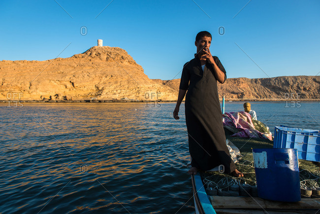 Sur, Oman - February 1, 2015: Fisherman having a smoke