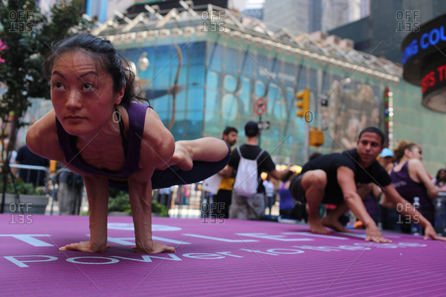New York City, New York - June 20, 2012: Yoga enthusiasts convene in New York's Times Square to mark the summer solstice