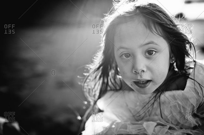 Black and white of young girl on a sunny day