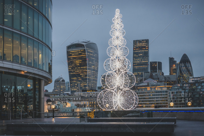 Queen's Walk in London with Christmas tree in the evening