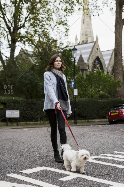 Young woman going walkies with her dog in London