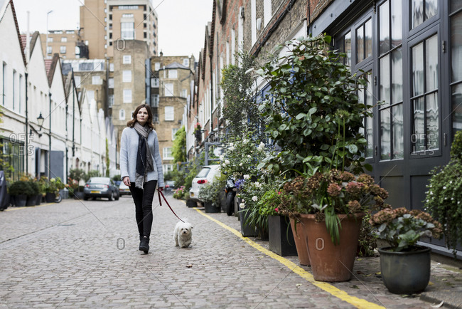 Young woman walking her dog