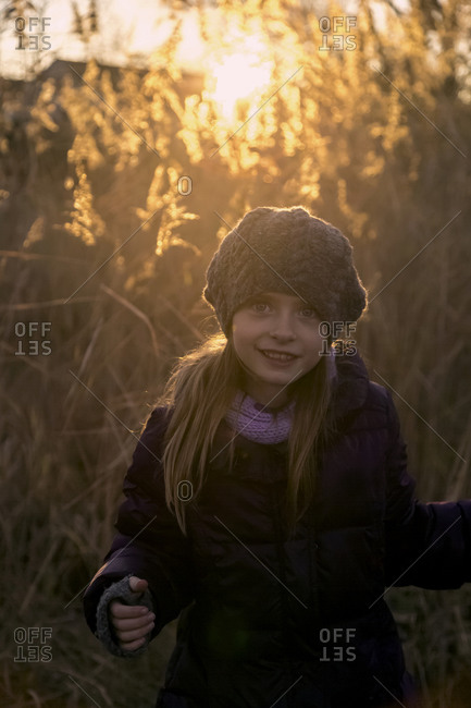 Portrait of girl in autumn at evening twilight